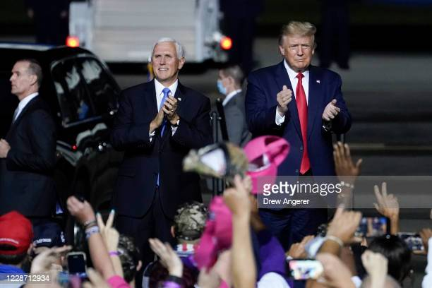 President Donald Trump and Vice President Mike Pence arrive for a campaign rally at Newport News/Williamsburg International Airport on September 25,...