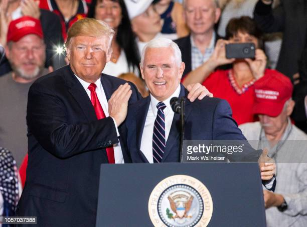 S President Donald Trump and Vice President Mike Pence at a campaign rally at the Pensacola International Airport on November 3 2018 in Pensacola...