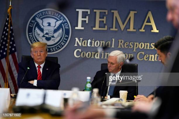 President Donald Trump and Vice President Mike Pence attend a teleconference with governors at the Federal Emergency Management Agency headquarters...