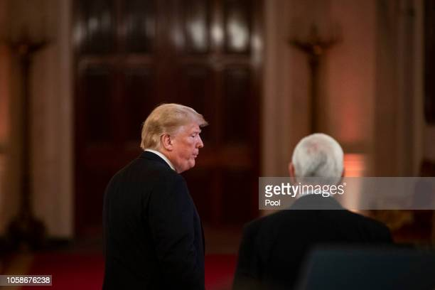 US President Donald Trump and Vice President Mike Pence depart after a news conference a day after the midterm elections on November 7 2018 in the...