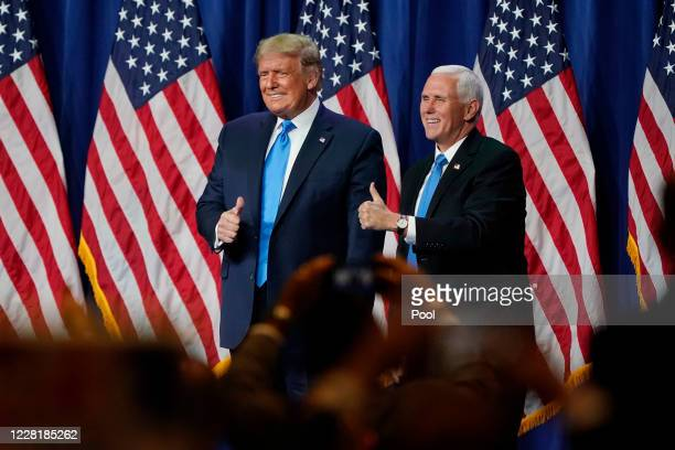 President Donald Trump and Vice President Mike Pence give a thumbs up after speaking on the first day of the Republican National Convention at the...