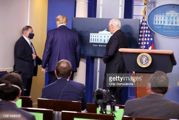 President Donald Trump and Vice President Mike Pence leave the stage after speaking to the press in the James Brady Press Briefing Room at the White...