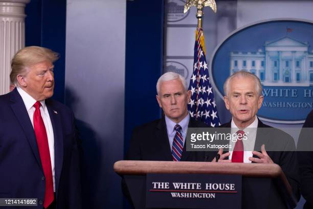 President Donald Trump and Vice President Mike Pence listen to Peter Navarro Director of the National Trade Council speak at the daily coronavirus...