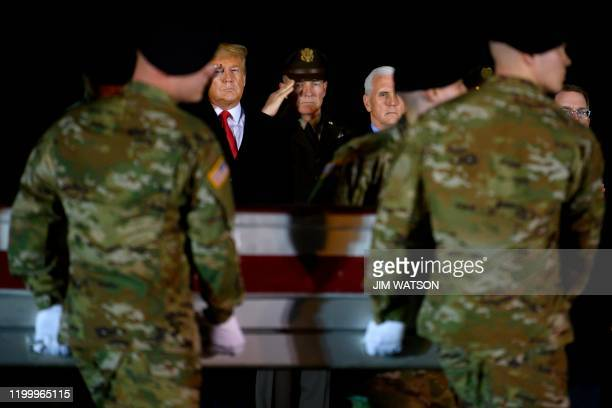 President Donald Trump and Vice President Mike Pence observe the dignified transfer of two US soldiers, killed in Afghanistan, at Dover Air Force...