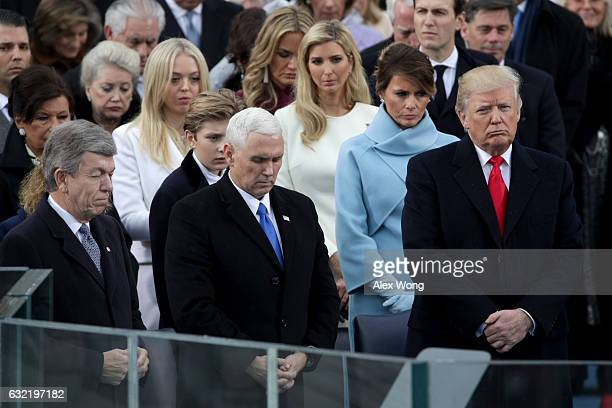 President Donald Trump and Vice President Mike Pence stand on the West Front of the US Capitol on January 20 2017 in Washington DC In today's...