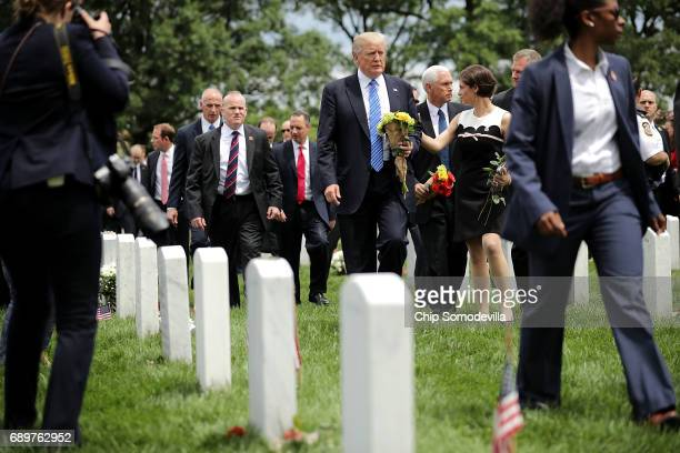 President Donald Trump and Vice President Mike Pence walk through Section 60 at Arlington National Cemetery on Memorial Day May 29, 2017 in...