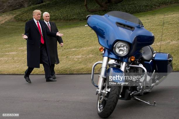 President Donald Trump and Vice President Mike Pence walk together on their way to greet Harley Davidson executives on the South Lawn of the White...