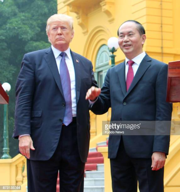 US President Donald Trump and Vietnamese President Tran Dai Quang meet the press after their talks in Hanoi on Nov 12 2017 Trump told Quang that he...