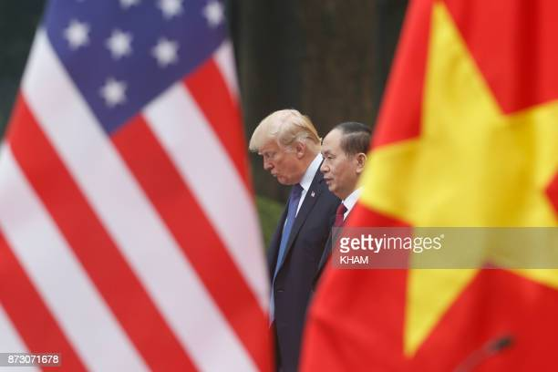 President Donald Trump and Vietnam's President Tran Dai Quang attend a press conference at the Presidential Palace in Hanoi on November 12 2017 Trump...