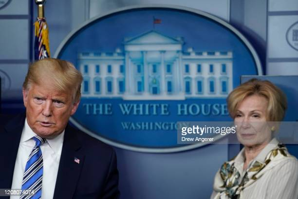 S President Donald Trump and White House coronavirus response coordinator Deborah Birx listen to questions during the daily coronavirus briefing at...