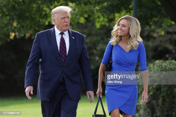 President Donald Trump and White House Press Secretary Kayleigh McEnany walk toward members of the press prior to Trump's departure from the White...