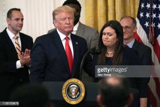 """S President Donald Trump and White House Press Secretary Sarah Sanders share a moment during an East Room event on """"second chance hiring"""" June 13..."""