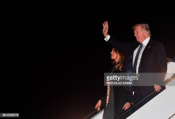 US President Donald Trump and wife Melania step off Air Force One upon arrival at Palm Beach International Airport in West Palm Beach Florida on...