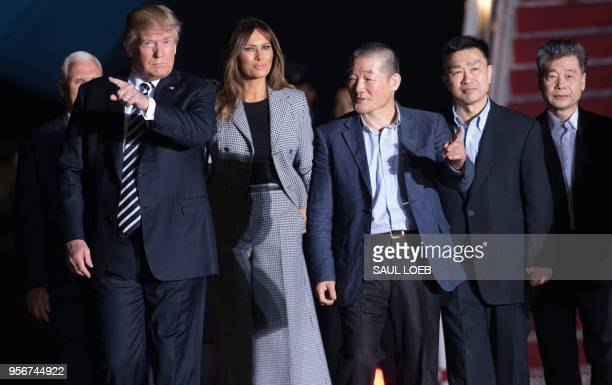 President Donald Trump and wife Melania Trump walk with US detainees Tony Kim Kim Haksong and Kim Dongchul upon their return after they were released...