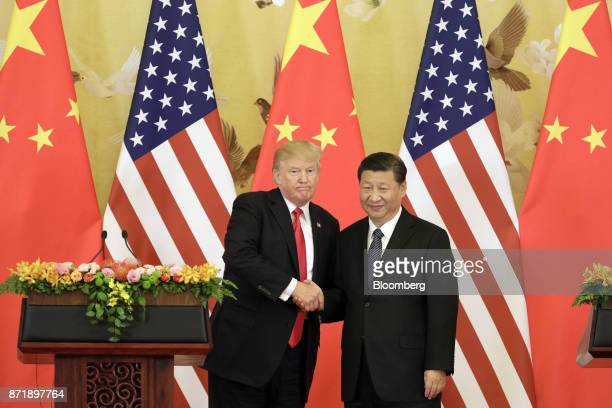 US President Donald Trump and Xi Jinping China's president shake hands during a news conference at the Great Hall of the People in Beijing China on...