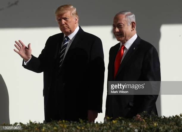 President Donald Trump andIsraeli Prime Minister Benjamin Netanyahuwalk along the colonnade at the White House on January 27, 2020 in Washington,...