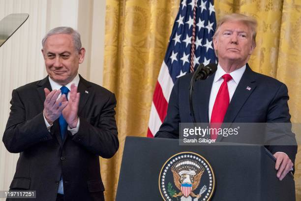 S President Donald Trump and Israeli Prime Minister Benjamin Netanyahu speak during a joint statement in the East Room of the White House on January...