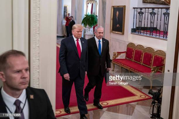 President Donald Trump andIsraeli Prime Minister Benjamin Netanyahuarrive to a joint statement in the East Room of the White House on January 28,...