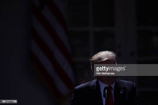 S President Donald Trump announces his decision to withdraw the United States from the Paris climate agreement in the Rose Garden at the White House...
