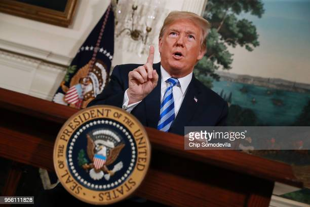 President Donald Trump announces his decision to withdraw the United States from the 2015 Iran nuclear deal in the Diplomatic Room at the White House...