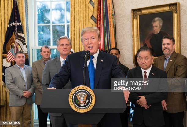US President Donald Trump announces that Broadcom will be moving back to the US in the Oval Office at the White House in Washington DC on November 2...