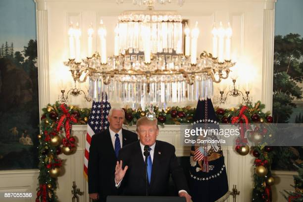 President Donald Trump announces that the US government will formally recognize Jerusalem as the capital of Israel as Vice President Mike Pence looks...