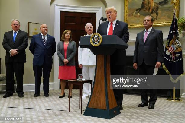 S President Donald Trump announces the $18 billion State Opioid Response Grants with Director of the White House Office of National Drug Control...