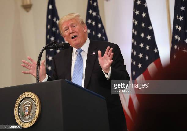 S President Donald Trump answers a question about people laughing at him the day before at the UN General Assembly while holding a press conference...