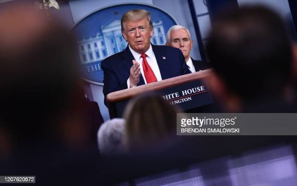President Donald Trump answers a question during the daily briefing on the novel coronavirus, COVID-19, at the White House on March 18 in Washington,...