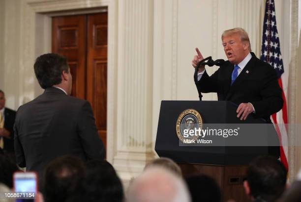 S President Donald Trump answers a question from Jim Acosta of CNN after giving remarks a day after the midterm elections on November 7 2018 in the...