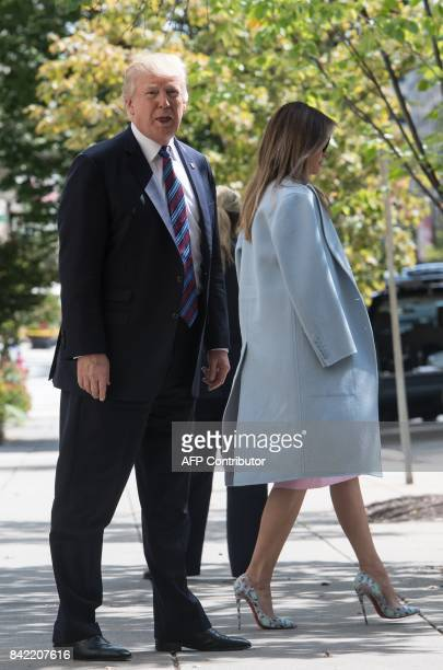 US President Donald Trump answers a question from the press as he and First Lady Melania Trump walk out of St John's Epicopal Church in Washington DC...