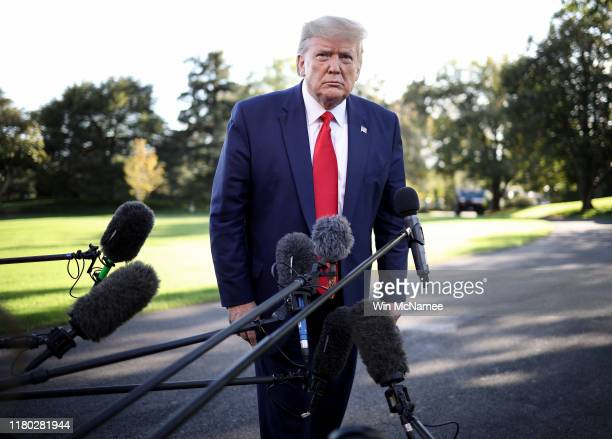 S President Donald Trump answers questions before boarding Marine One while departing the White House on October 10 2019 in Washington DC Trump is...
