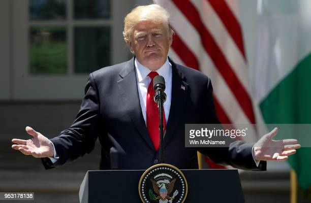 S President Donald Trump answers questions during a joint press conference with Nigerian President Muhammadu Buhari in the Rose Garden of the White...