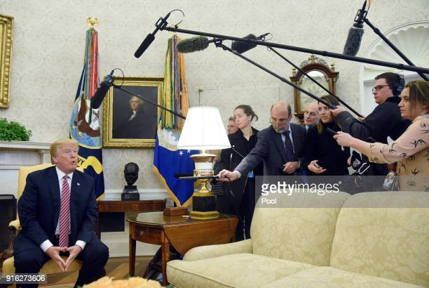 US President Donald Trump answers questions during a meeting with Don Bouvet who has been battling cancer in the Oval Office of the White House...
