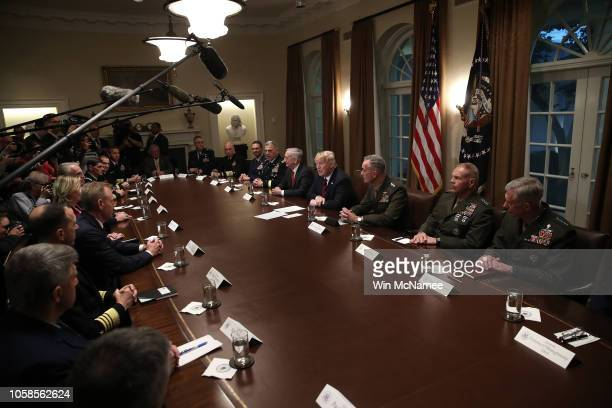 S President Donald Trump answers questions during a meeting with military leaders in the Cabinet Room on October 23 2018 in Washington DC Trump...