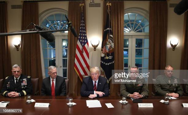 President Donald Trump answers questions during a meeting with military leaders in the Cabinet Room on October 23, 2018 in Washington, DC. Trump...