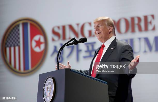 S President Donald Trump answers questions during a press conference following his historic meeting with North Korean leader Kim Jongun June 12 2018...