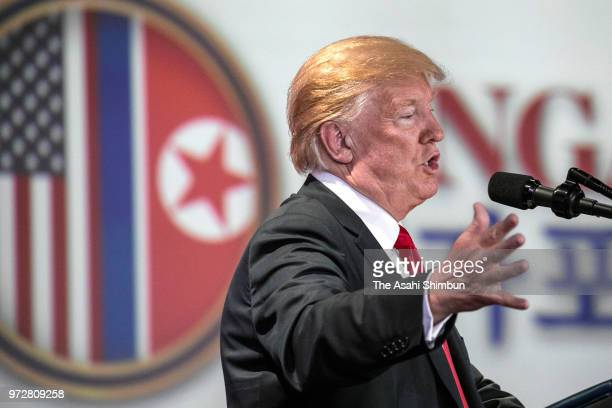US President Donald Trump answers questions during a press conference following his meeting with North Korean leader Kim Jong Un on June 12 2018 in...