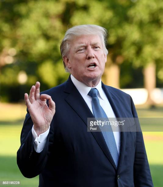 US President Donald Trump answers questions from the press after stepping off Marine One on the South Lawn on September 24 2017 in Washington DC