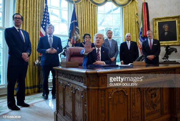US President Donald Trump answers reporters questions after signing the Paycheck Protection Program and Health Care Enhancement Act in the Oval...