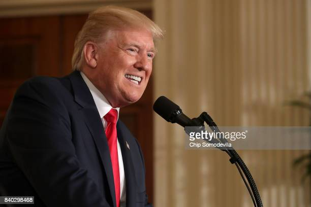 S President Donald Trump answers reporters' questions during a joint news conference with Finnish President Sauli Niinisto in the East Room of the...
