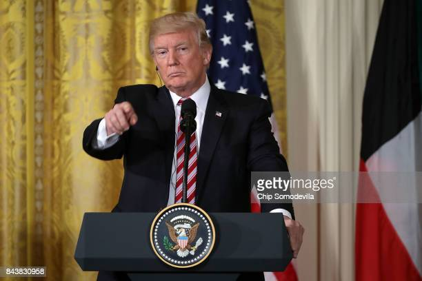 S President Donald Trump answers reporters' questions during a joint news conference with Amir Sabah AlAhmad AlJaber AlSabah of Kuwait in the East...