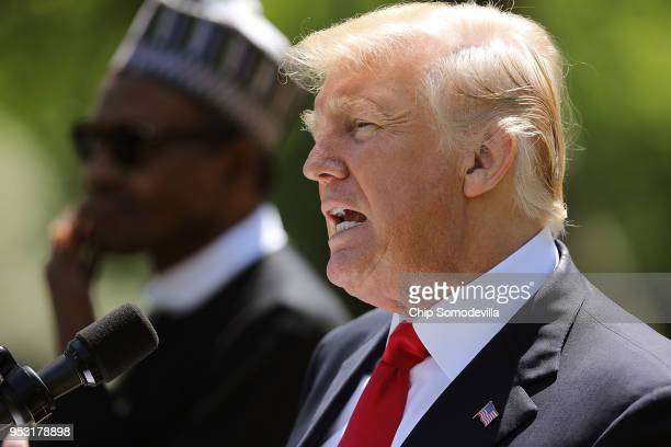 S President Donald Trump answers reporters' questions during a joint news conference with Nigerian President Muhammadu Buhari in the Rose Garden of...
