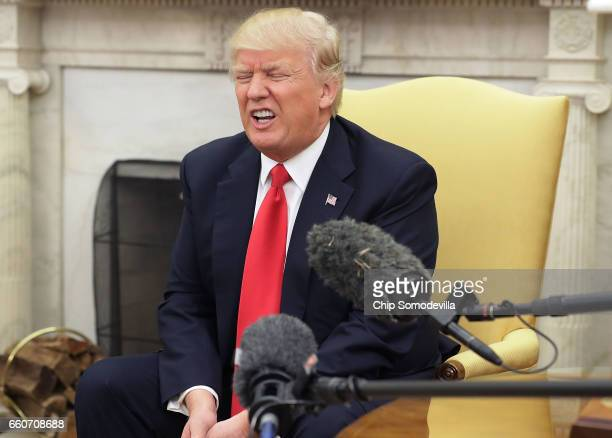 President Donald Trump answers reporters' questions during a photo opportunity with Prime Minister Of Denmark Lars Lokke Rasmussen in the Oval Office...