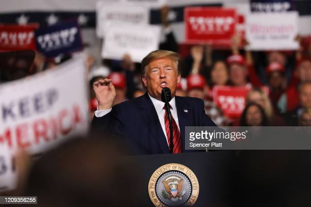 President Donald Trump appears at a rally on the eve before the South Carolina primary on February 28, 2020 in North Charleston, South Carolina. The...