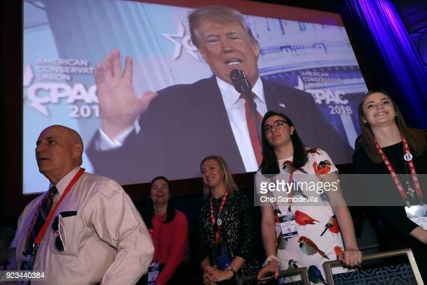 S President Donald Trump appears on a large video screen while addressing the Conservative Political Action Conference at the Gaylord National Resort...