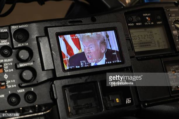 S President Donald Trump appears on a television camera monitor during a meeting with state and local officials to unveil his administration's...