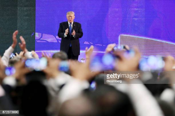 US President Donald Trump applauds after speaking at the AsiaPacific Economic Cooperation CEO Summit in Danang Vietnam on Friday Nov 10 2017...