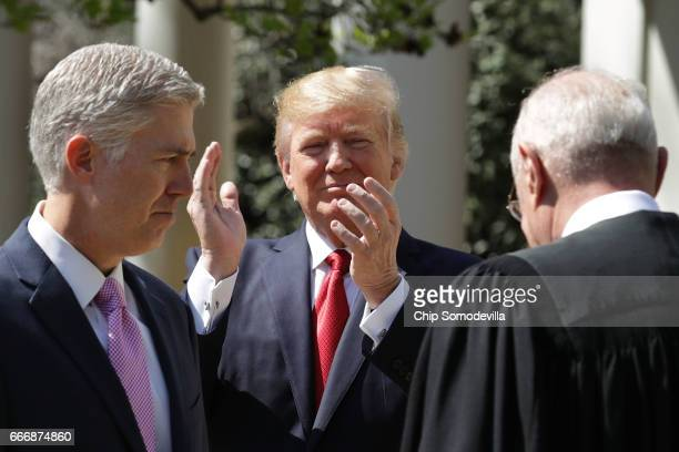 S President Donald Trump applauds after Supreme Court Associate Justice Neil Gorsuch took the judicial oath during a ceremony in the Rose Garden at...