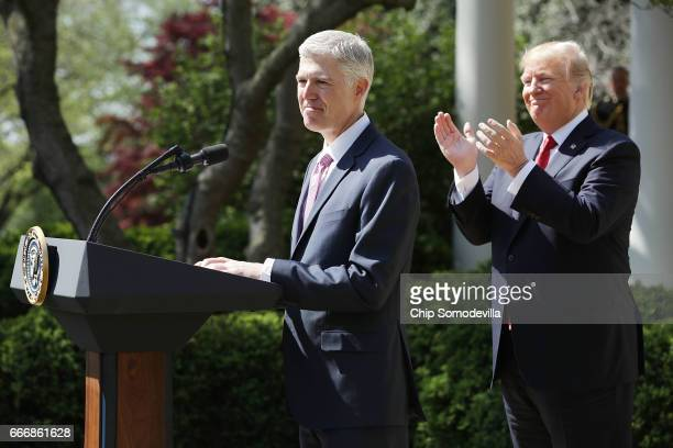 S President Donald Trump applauds as Supreme Court Associate Justice Neil Gorsuch delivers remarks after taking the judicial oath during a ceremony...